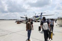 Passengers Walking To Board Airplane Stock Photos