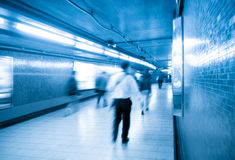 Passengers walking in underpass. Passengers walking blur with subway passageway in hong kong Stock Photo