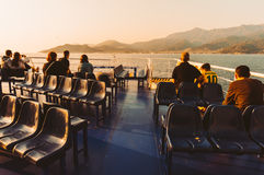Passengers watching the sea from a ferry Stock Photography