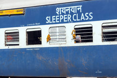 Passengers at the windows of a moving Indian Railway waggon Royalty Free Stock Photo