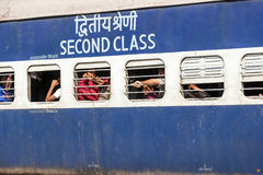 Passengers at the windows of a moving Indian Railway waggon Royalty Free Stock Image