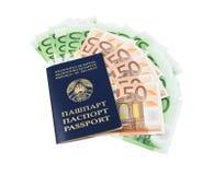 Passeport biélorusse avec des euro Photographie stock libre de droits