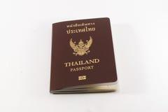 Passeport de la Thaïlande sur un fond blanc photos stock