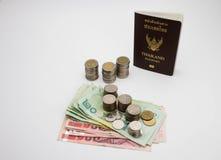 Passeport et argent Photos libres de droits