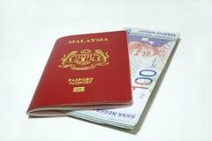 Passeport et notes de la Malaisie Photographie stock