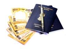 Passeports et argent photographie stock