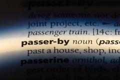 Passer by. Word in a dictionary.  concept stock images