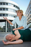 Passerby pleading for first aid Stock Images