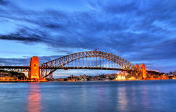 Passerelle de port de Sydney au coucher du soleil Image stock