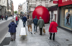 Passersby look at Kurt Perschke's giant Red Ball Stock Photo