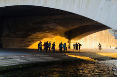 Passersby walking under Iena bridge, Seine river, Paris Royalty Free Stock Image