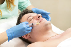 Passes a course of mesotherapy clinic. Man passes a course of mesotherapy clinic Stock Photos