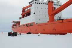 Cargo ship arrives in port for unloading on an ice floe. royalty free stock image