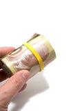Passi giudicare un rotolo di 100 dollari canadese Immagini Stock Libere da Diritti