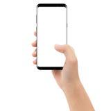 Passi il cellulare del telefono della tenuta isolato su fondo bianco fotografia stock libera da diritti