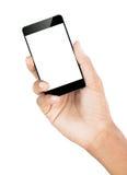 Passi il percorso di ritaglio bianco isolato smartphone della tenuta dentro Immagine Stock
