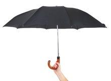 Passi l'ombrello della holding fotografie stock