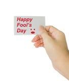 Passi la carta della tenuta con il giorno dello sciocco felice di parola Fotografia Stock Libera da Diritti