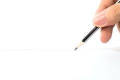 Passi la matita della tenuta Fotografie Stock Libere da Diritti
