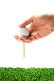 Passi la sfera di golf della holding Immagine Stock Libera da Diritti