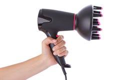 Passi la tenuta del hairdryer Fotografie Stock Libere da Diritti