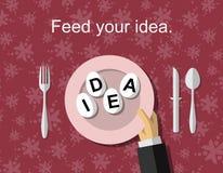 Passi la tenuta del piatto con le uova segnate IDEA su, concetto astratto Immagine Stock