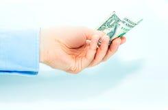 Passi la tenuta o dare il dollaro dei soldi su fondo bianco Fotografia Stock