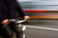 Passing. A man is riding bike stock images