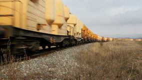Passing cargo train. Freight train with petroleum tank cars passing by stock footage