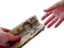 Passing Cash. Two People passing cash to each other Royalty Free Stock Photography