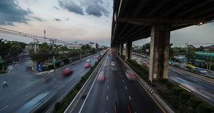 Passing Cloud And Traffic At Twilight In Bangkok. Timelapse day to night of passing cloud and traffic at twilight in Bangkok stock video footage