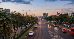 Passing Cloud And Traffic At Twilight In Bangkok. Timelapse day to night of passing cloud and traffic at twilight in Bangkok stock video
