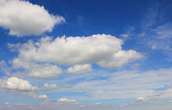 Passing clouds on dark blue sky Royalty Free Stock Photo