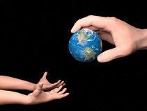 Passing the earth from adult to child Royalty Free Stock Photo