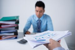 Passing financial document Stock Image