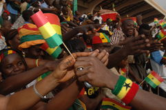 Passing a Flag. March 6, 2007 - A jubilant crowd in Accra, Ghana, reaches for flags being handed out at the start of Independence Day celebrations marking 50 Royalty Free Stock Images