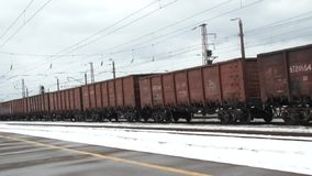 By passing freight train station stock video footage
