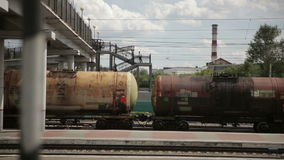 Passing freight train. Freight train passing under a viaduct stock video