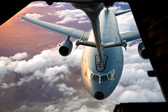 Passing Gas. An Air Force KC-10 Extender receives fuel inflight royalty free stock photography