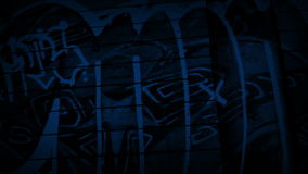 Passing Graffiti On Side Of Building At Night. Tracking shot moving slowly past graffiti in the dark stock video footage