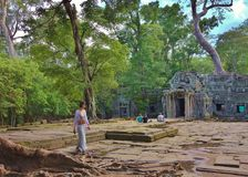 Passing lady at temple of Angkor Wat Stock Photography