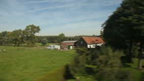 Passing landscape from a train window. View of passing landscape from a train window stock video footage