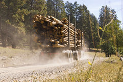 Passing logging truck Stock Image