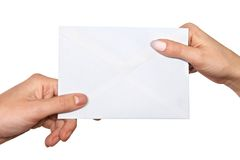 Passing mail. Hands passing mail isolated over white background Royalty Free Stock Photo
