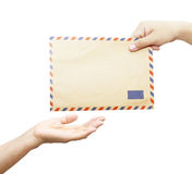 Passing mail. Man's hand passes the envelope to another hand isolated on white background Royalty Free Stock Photos