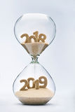 Passing into New Year 2019. New Year 2019 concept with hourglass falling sand taking the shape of a 2019 royalty free stock images