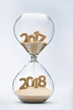 Passing into New Year 2018. New Year 2018 concept with hourglass falling sand taking the shape of a 2018 Stock Photography