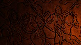 Medieval Soldiers Wall Carving In Fire Glow
