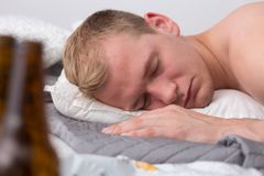 Passing out from buzz. Young guy is sleeping of after partying royalty free stock photos