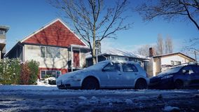 Passing Parked Cars By Houses In The Snow. Moving past parked cars by houses after heavy snowfall stock video